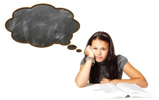 Girl sitting in front of a textbook, with an empty thought cloud from her head