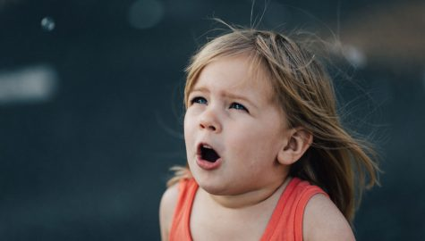 Young girl reacting intensely