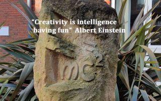 sculpture E=MC2 on Open University MK campus, Words say Creativity is intelligence having fun - Albert Einstein