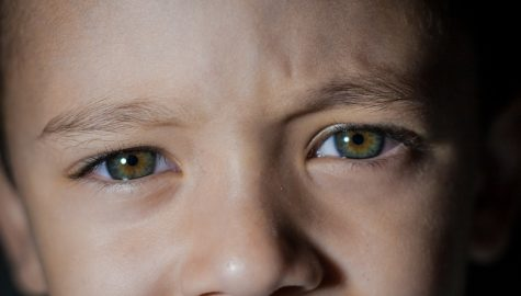 Detail of child's face with a confused look