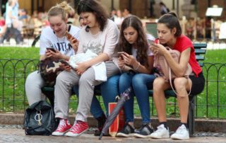 group of teenage girls on their phones