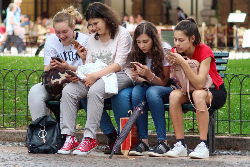 group of teenage girls on their phones