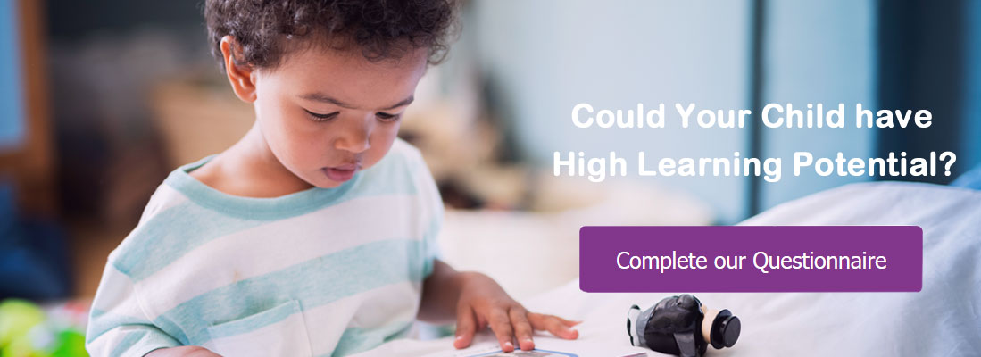 young boy reading. Could your child have high learning potential. complete our questionnaire