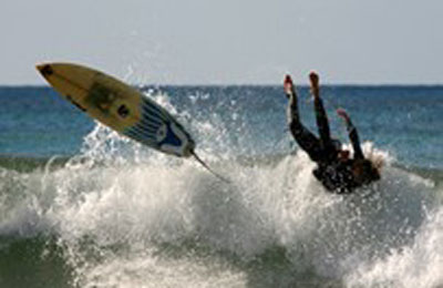teenager surfing wipeout