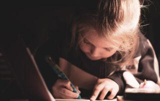 Young girl writing