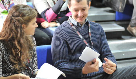 Two people chatting at a conference