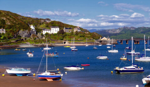Boats, some beached and some floating at Barmouth