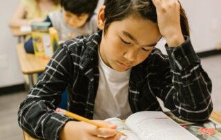 teenage boy working at his desk
