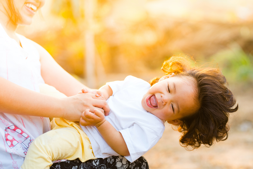 young child being spun around by her mother