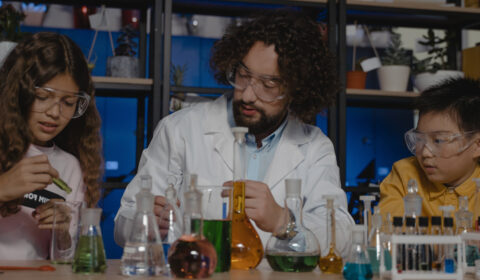 Science demonstration with man working with two young people