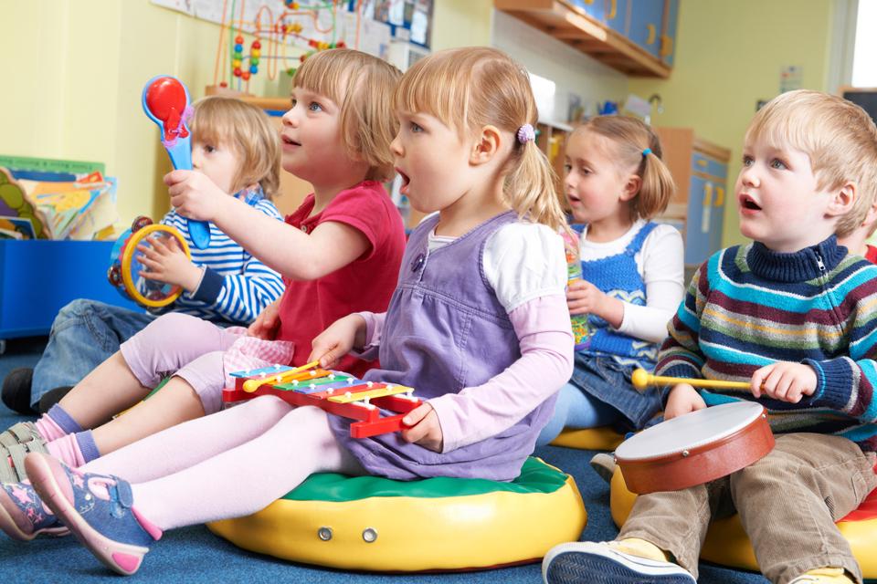 nursery children having a music lesson