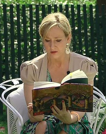 J.K. Rowling reading a Harry Potter book