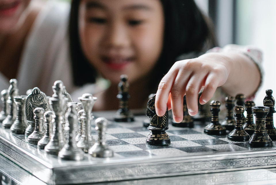 young child playing chess